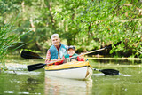 Kayaking on river in forest. Family on canoe. Active recreation and vacation - 230390143