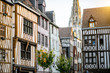 Street view with beautiful old buildings and cathedral tower on the background in Rouen city, the capital of Normandy region in France - 230391959