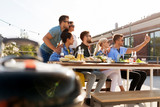leisure and people concept - happy friends with drinks having barbecue party on rooftop in summer and taking selfie by smartphone - 230402933