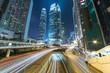 Leinwanddruck Bild - Traffic in downtown of Hong Kong city ar night