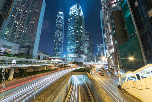 Leinwanddruck Bild Traffic in downtown of Hong Kong city ar night