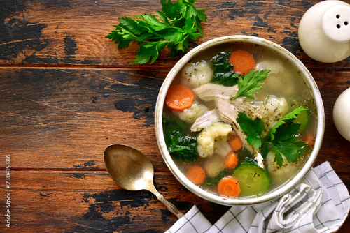 Leinwanddruck Bild Vegetable soup with chicken fillet.Top view with copy space.
