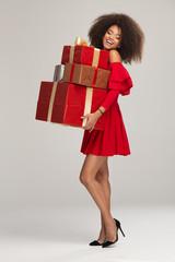Female model wear red dress keeps gifts