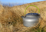 tourist kettle in dry grass - 230421372