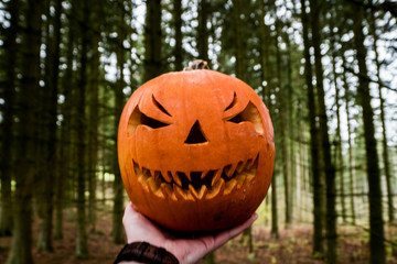 scary halloween pumpkin in the hand