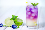 Butterfly pea flower drink with lime , honey and mint leaf , a fresh herbal healthy detox drink