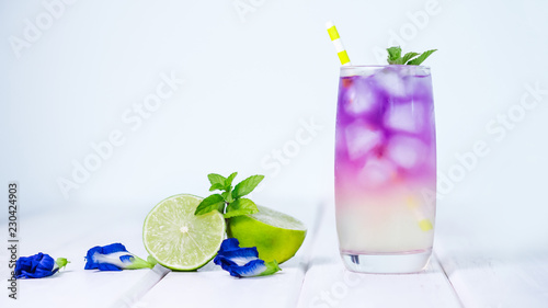 Butterfly pea flower drink with lime , honey and mint leaf , a fresh herbal healthy detox drink - 230424903