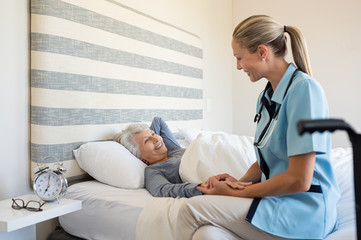 Nurse checking senior woman at home