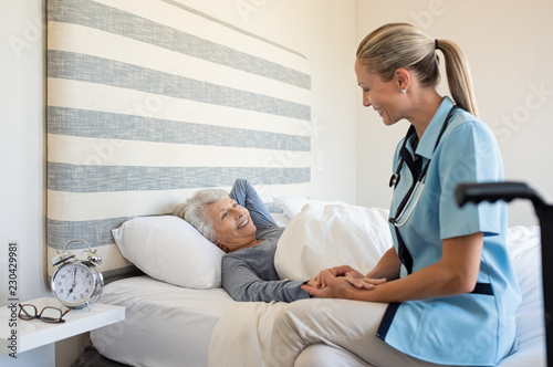 Nurse checking senior woman at home - 230429981