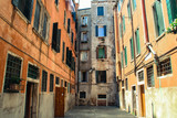 beautiful street with houses in venice italy