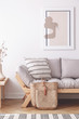 Abstract painting on the wall of natural beige living room with grey settee in lagom inspired interior