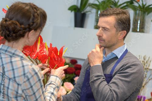 Leinwandbild Motiv Male florist in contemplation