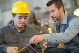 boss and worker in yellow hard hat at warehouse - 230461543