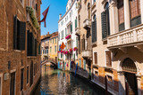 Picturesque buildings on a deserted canal in Venice, Italy. - 230462778