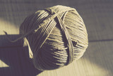Vintage Style Image of Still life with rustic rope ball on the w - 230463185