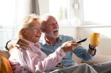 Senior couple watching tv