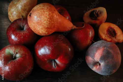 Foto Murales tasty juicy fruits on a black background