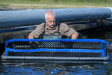 Man stood in contained area for fish farming - 230475345
