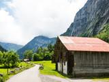 Barn near road in Lauterbrunnen Switzerland - 230479560