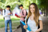 Happy students outdoor smiling - 230481133
