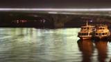 Pleasure boats on the quay at night, tourist pleasure boats at night, Quay at night timelapse, Pleasure boats on the bridge background at night - 230481908