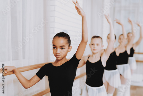 Leinwanddruck Bild Ballet Training of Group of Young Girls Indoors.