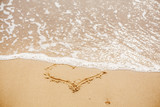 Heart written on sandy beach with wave near sea. Love concept. Happy valentine's day.  Honeymoon for newlyweds. Valentine day. Space for text. Happy holidays. Broken heart - 230498500