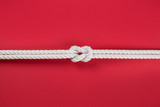 White ship ropes connected by reef knot - 230501106