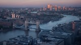 time lapse London skyline with illuminated Tower bridge and Canary Wharf in sunset time, UK - 230506127