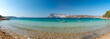 Leinwandbild Motiv Panoramic view of North Sardinia beach with Tavolara island on the background