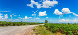 Wind turbine farm in beautiful nature with blue sky blackground, generating electricity in Nakorn Ratchasima Thailand