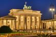 The beautifully illuminated Brandenburg Gate in Berlin at dawn