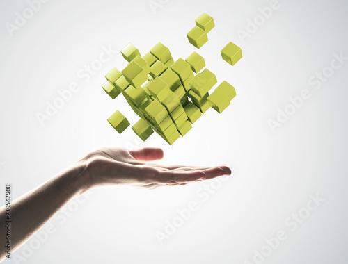 Leinwanddruck Bild Cube color figure in male palm as symbol for integration. 3D ren
