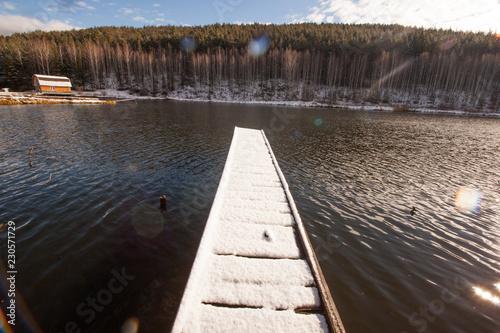 Acrylglas Pier wooden bridge by the lake, Sunny day