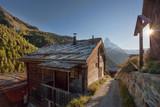 Old cottage with Matterhorn peak in Zermatt area, Switzerland - 230580333