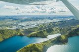 aerial landscape of nature in Iceland, volcanic mountains and lakes in highlands from small airplane - 230581120