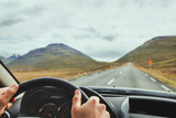 travel, driving car on a beautiful scenic road in Iceland - 230581127