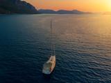 Bare boat during sunrise in Mediterranean Sea - 230589308
