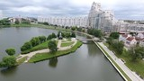 Summer in the Minsk city centre downtown snow sunny day residential buildings near river drone shot from above aerial - 230594986