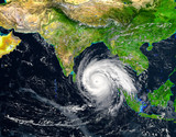 tropical hurricane moving across the Indian Ocean.Elements of this image are furnished by NASA.. - 230595311