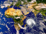 Tropical hurricane moving across the Indian Ocean.Elements of this image are furnished by NASA.. - 230595545