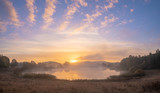 Beautiful misty sunrise over the lake - 230595764