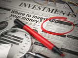 ETF is a best option to invest. Where to Invest concept, Investmets newspaper with loupe and marker. - 230598758