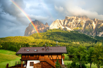 Rainbow after the storm on Dolomites Alps