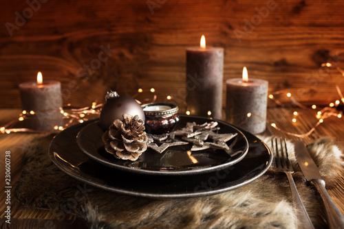 Leinwandbild Motiv Christmas table setting for a dinner