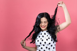 Happy young woman on a pink background - 230614915