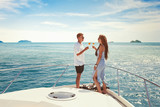 summer vacation travel, romantic couple drinking champagne on luxury yacht, sea holidays - 230617312