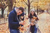 Couple having fun in autumn park. Happy people in fall season. - 230617332