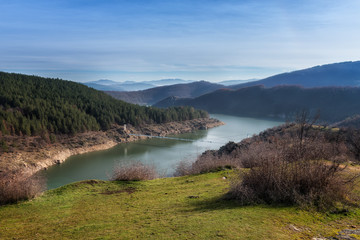 Mountain lake in sunny winter day / An amazing day view of Studen Kladenetz dam and a bridge over it, which is situated in Eastern Rhodopes Mountains, Bulgaria