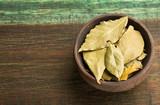 Aromatic laurel leaves - Laurus nobilis. Wood background - 230627162